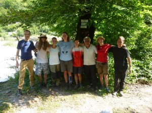 A tourist trail team with a local man.